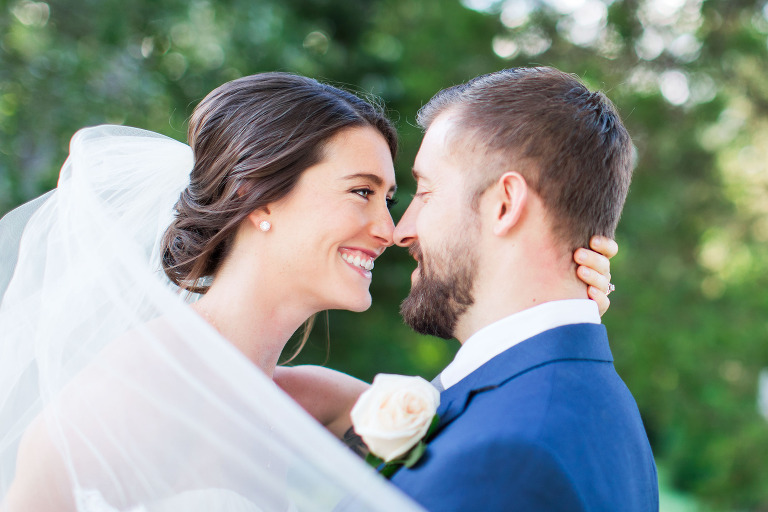 bride with low bun and veil blowing in the wind