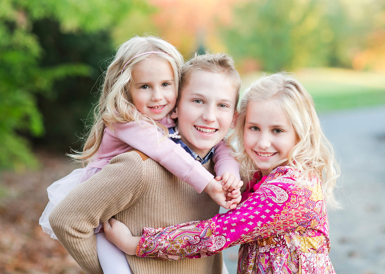 three blonde siblings in outdoor fall portrait in ruxton